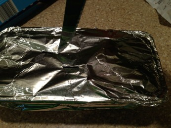 After wood soaks for 30 min or so, drain the water, cover tightly with foil and cut slits in the top.