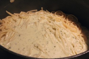 Pour sauce over drained pasta and toss gently