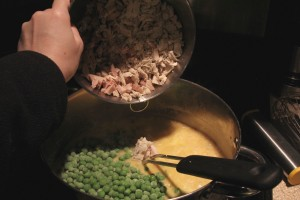 Adding in peas and meat