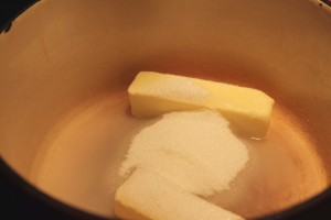 Combine butter, sugar, and water in a large heavy pot.