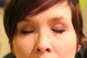 Makeup on both eyes.